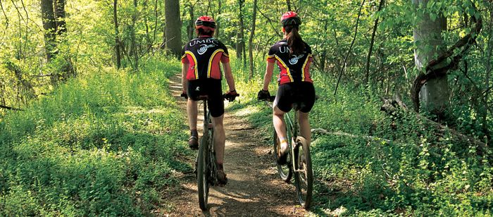 UMBC students biking in Patapsco Park which runs along the Patapsco River, adjacent to the the UMBC campus. Photo by Howard Korn.
