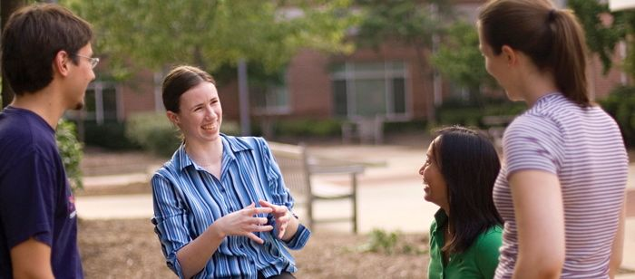 UMBC students interacting in the courtyard of Erickson Hall.  Photo by Chris Hartlove.