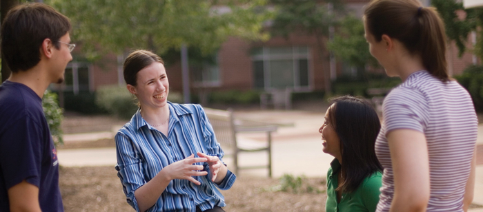 UMBC students interacting on the courtyard of Erickson Hall.  Photo by Chris Hartlove