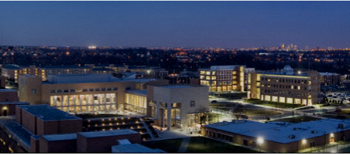 UMBC campus at night with Baltimore's skyline in the background