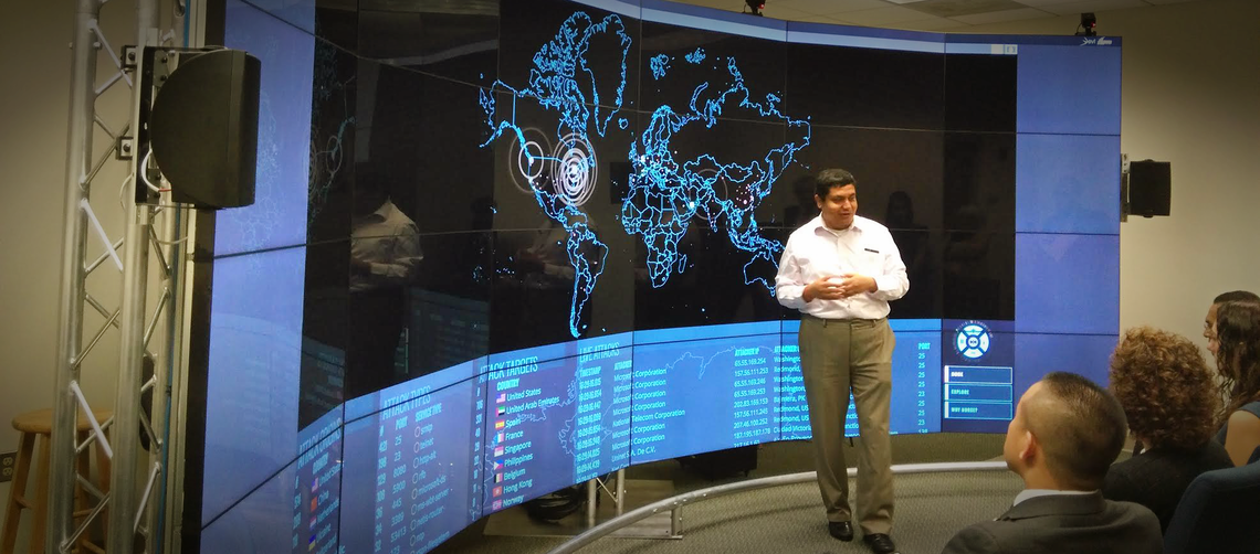 Prof. Anupam Joshi talking in front of the π² Immersive Hybrid Reality display