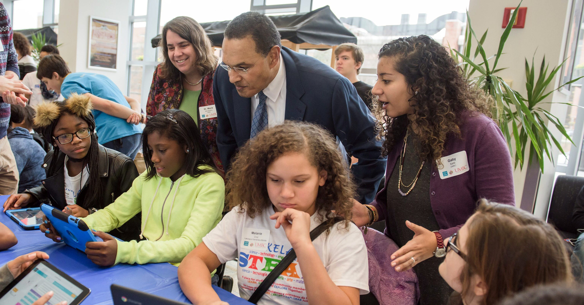 Dr. Marie desJardins, President Freeman Hrabowski, and Gabrielle Salib '17, interdisciplinary studies, working with Lakeland Elementary/Middle School students at the Hour of Code.