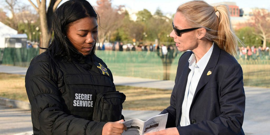two secret service agents confer
